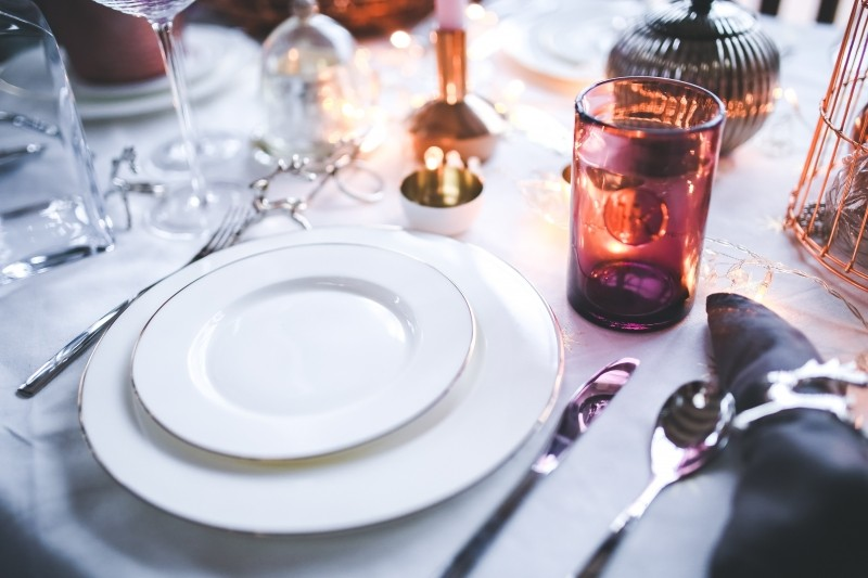 elegant-table-with-plates-and-glasses-on-white-tablecloth.jpg